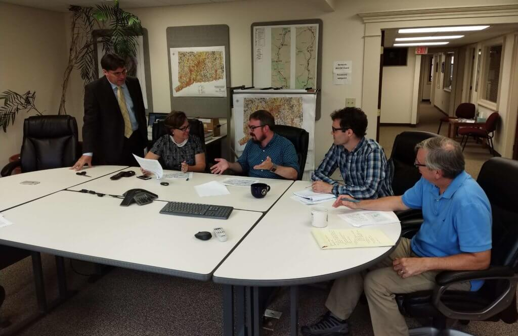 Picture of planners around table reviewing documents